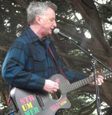 Singer Billy Bragg performing at the Tuition fees demo in Taunton